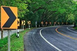Tight curve with warning signs
