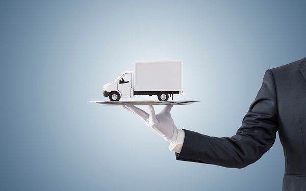Hand with white glove holding truck